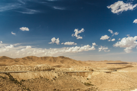 matmata: Road passes through rocky Sahara desert, Tunisia. Africa