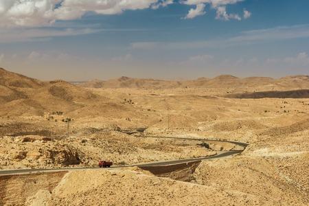 matmata: Road passes through rocky Sahara desert, Tunisia.