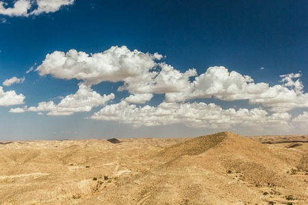 matmata: Mountain views in the desert. Tourists on top of a hill. Tunisia, Africa.