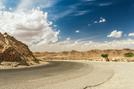 Road passes through rocky Sahara desert, Tunisia. Africa