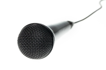 Close up of microphone on isolated white background photo