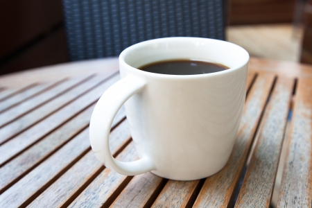 roundtable: Close up of coffee in white cup Stock Photo