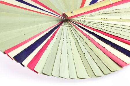 Traditiional fold fan made of dry palm leaves photo