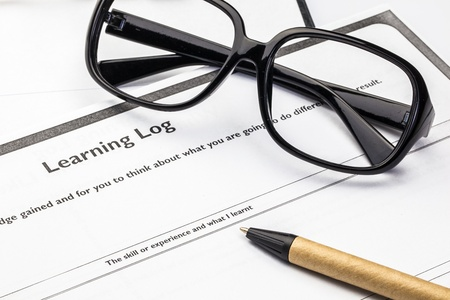 Learning log blank form with glasses and pen Stock Photo