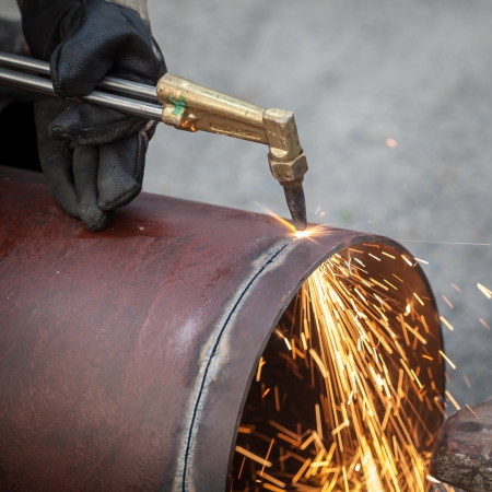 acetylene: Worker cut big pipe with spark light