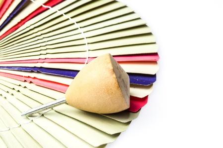 trompo de madera: Cierre de madera encima, antiguo juguete en fan fold