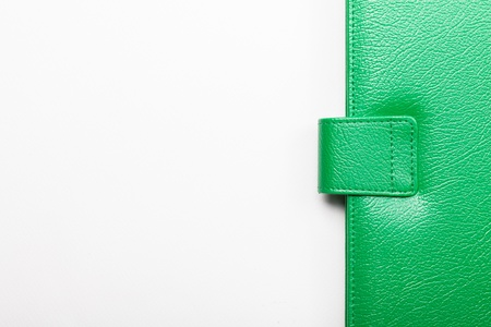 Close up of green leather cover of notebook photo