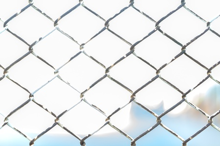 Close up of metal twist fence with orange light background Stock Photo - 20927771