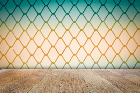 Close up of metal twist fence with wooden floor Stock Photo - 20927774