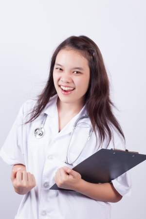 Smiling young woman doctor holding black cardboard