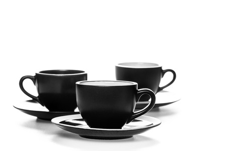 Pile of coffee cups on white background photo