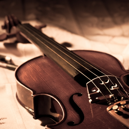 Vintage violin and bow in still life concept photo