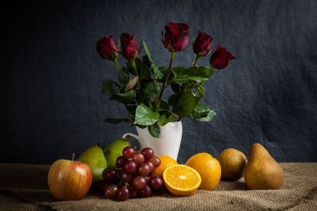 Still life fruits, fresh fruit display in wooden basket and some place on sack cloth photo