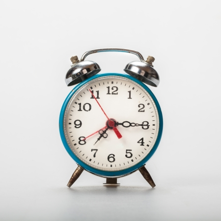 Old alarm clock on isolate white background