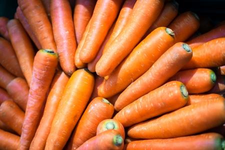 carotene: Close-up of fresh nutritive carrots, source of vitamin A and beta carotene