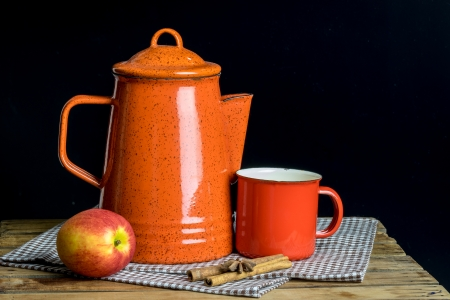 freshment: Still life, red tea pot set and apple on table cloths in dark background