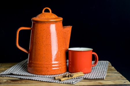 freshment: Still life, red tea pot set and cinamon sticks on table cloths in dark background