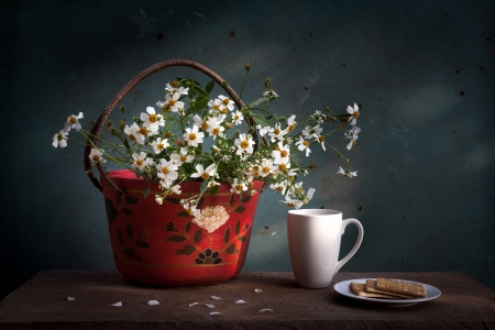 freshment: Still life red basket with white flower, coffee cup and biscuits on wooden table
