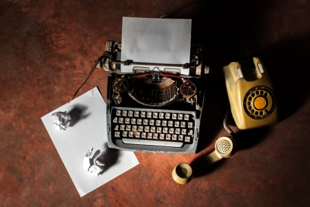 Old English type writer with paper sheet and aged lantern Stock Photo