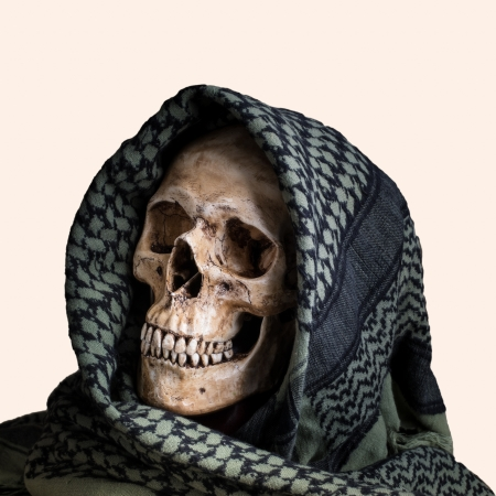 Human skull with shemagh cloth on isolated white photo