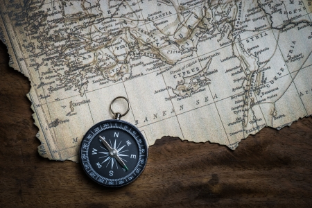 Old compass and vintage map photo