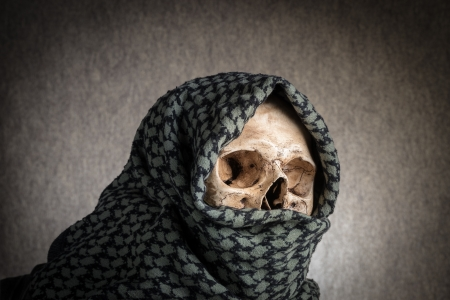 Human skull with shemagh cloth photo