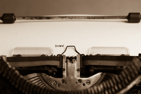 Word Debt on white paper in the old typewriter photo