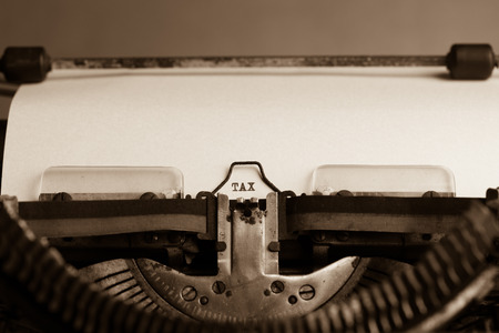 Word TAX on white paper in the old typewriter photo