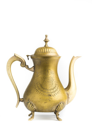 Antique brass teapot isolated on white photo