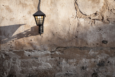 Vintage lantern on grunge wall photo