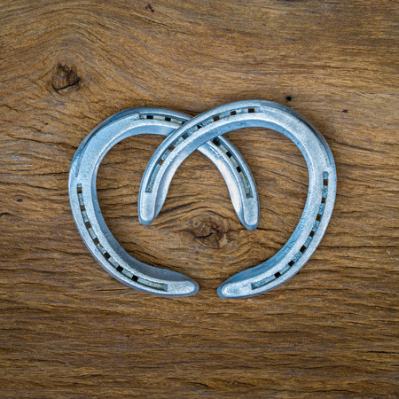 animal st  patricks day: Horse shoes on wooden table Stock Photo