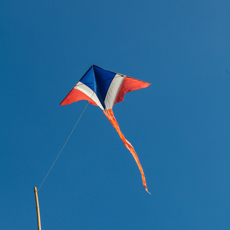 Thai kite in isolated blue sky photo