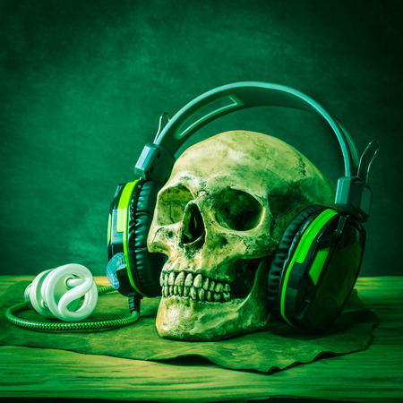part body: Still life with human skull wearing headphones