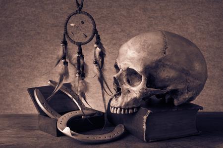 Still life with human skull horseshoe and dream catchers photo