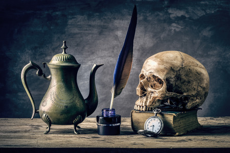 Still life with human skull vintage antique pocket watch, brass tea pot and  grunge book photo