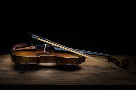 Still life with vintage violin and bow Stock Photo