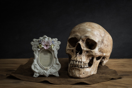 Still life with human skull classic picture frame photo
