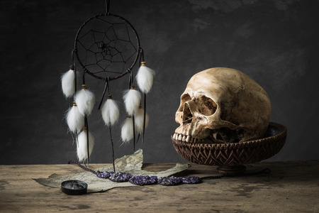 Still life with human skull  and dream catchers photo