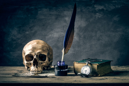 Still life with human skull vintage antique pocket watch and  grunge book photo
