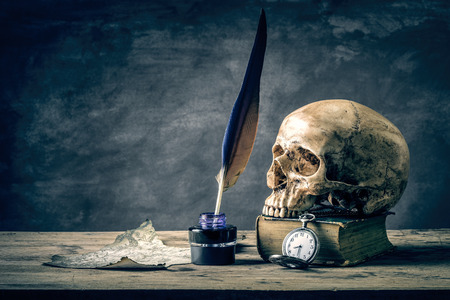 Still life with human skull vintage antique pocket watch, map and  grunge book photo