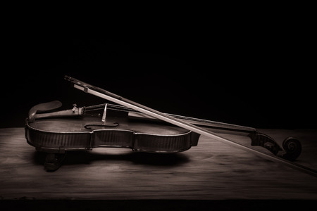 Still life with vintage violin and bow photo