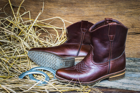 Western cowboy boots and horseshoes ,Still life vintage style Stock fotó