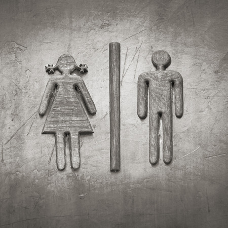 Restroom sign made of teak wood on concrete wall photo