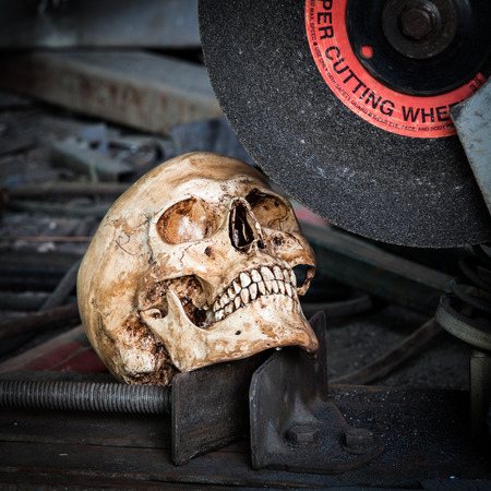Still life with human skull and old sewing machine photo