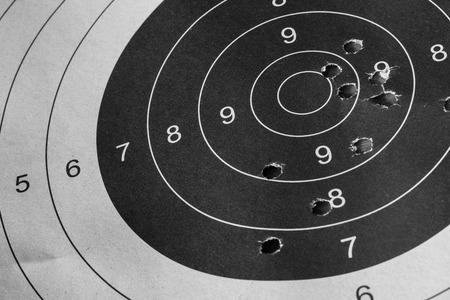 bullet hole: Bull eyd target with bullet hole