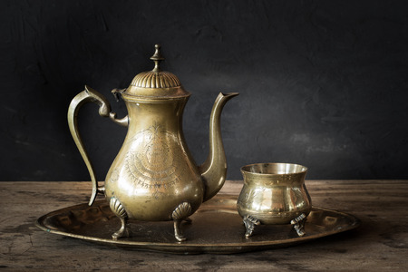 pewter: Still life with antique teapot on wooden table Stock Photo