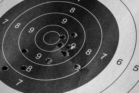 Bull eyd target with bullet hole