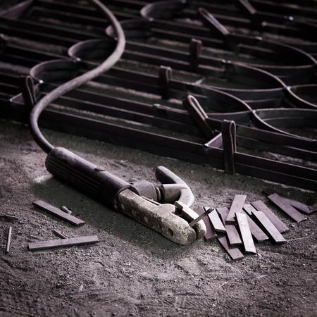 Still life with welding handheld on ground floor