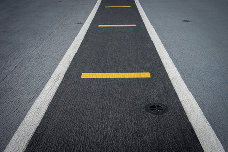 inhibition: Runway on battleship and runway Aircraft Carrier Stock Photo