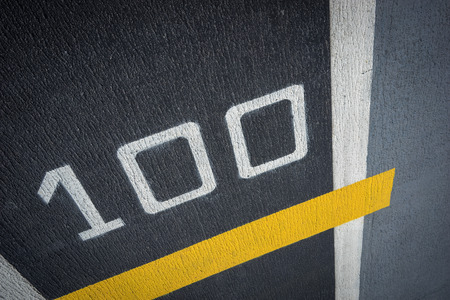 strips away: Runway on battleship and runway Aircraft Carrier with number 100 on yellow line